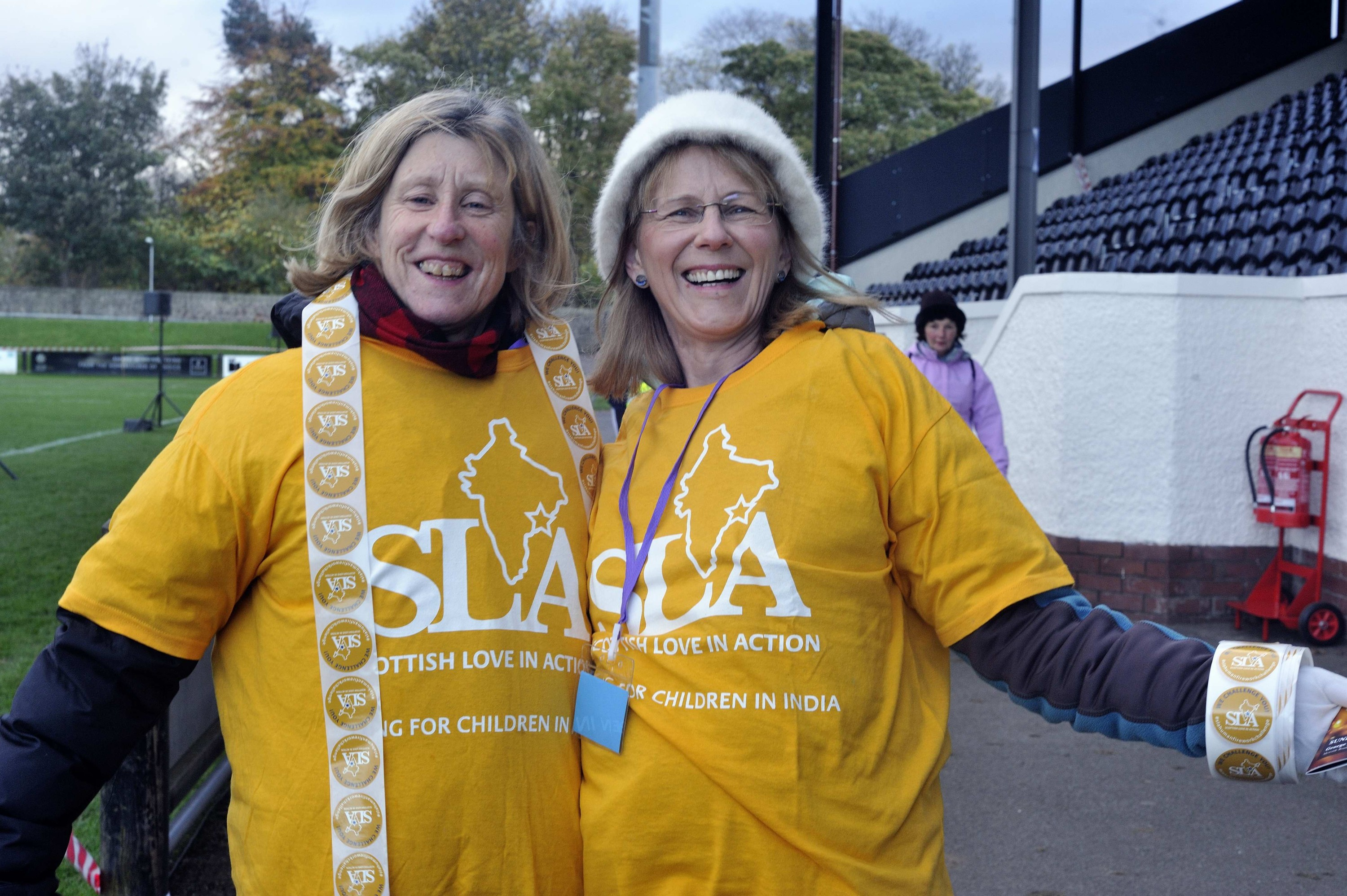Two volunteers at the 2016 Scottish Love in Action annual fireworks event in Edinburgh, Scotland.
